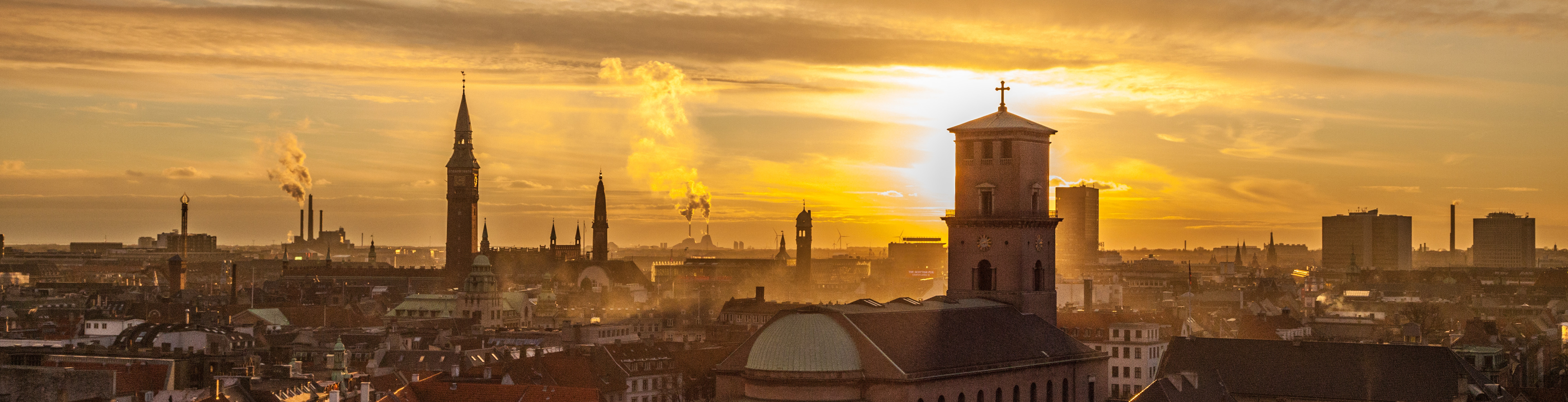 The Copenhagen skyline in evening light with the tower of the Copenhagen cathedral