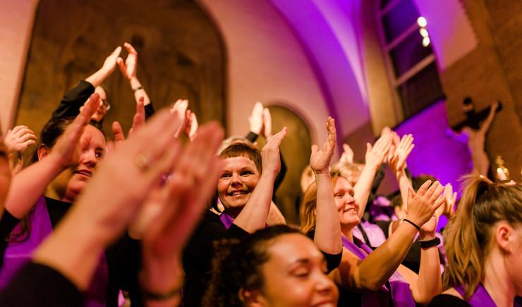 Choir clapping their hands